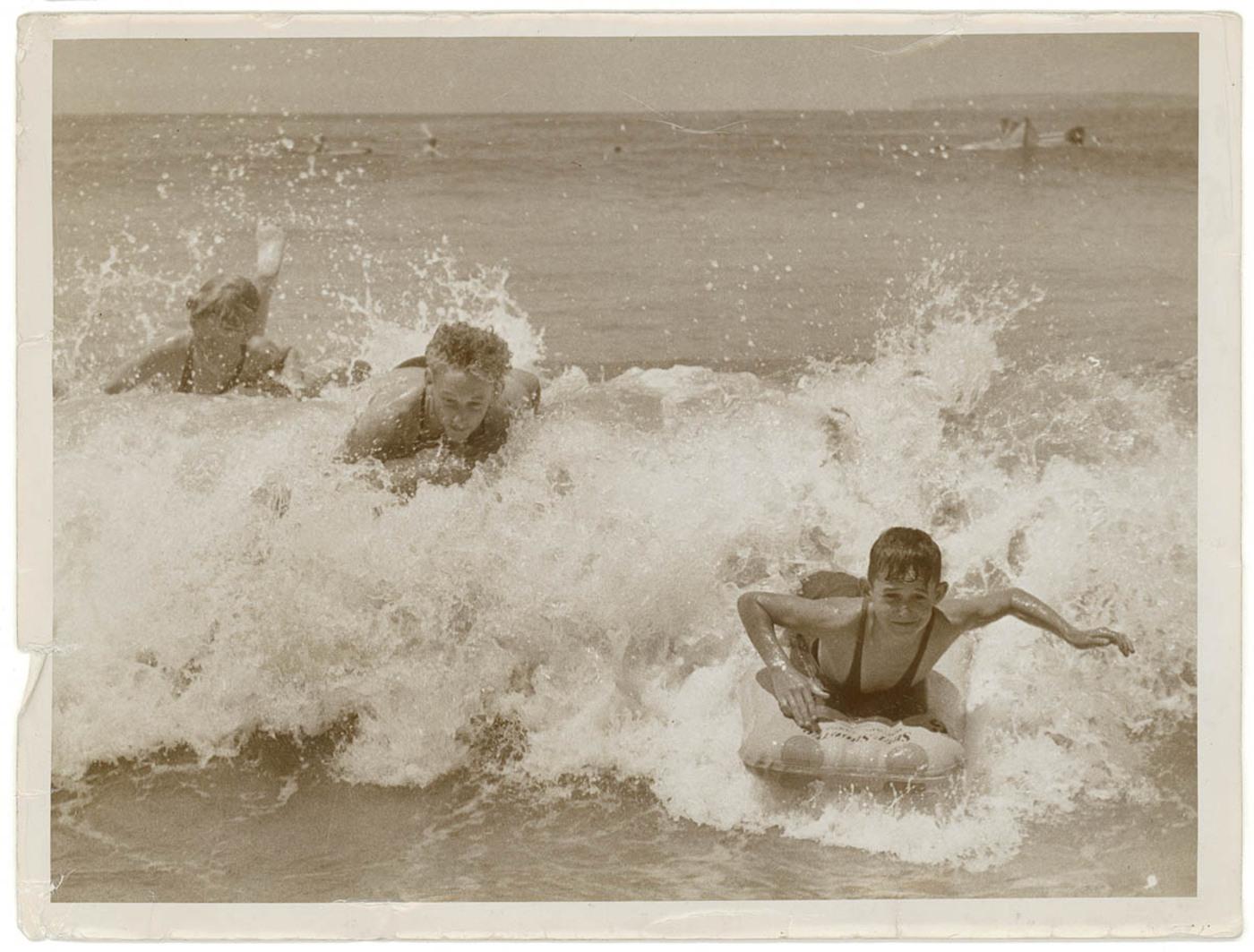 Surfoplane riding at a Sydney beach, 193- / Sam Hood