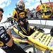 Graham Rahal climbs into his machine at Pocono Raceway