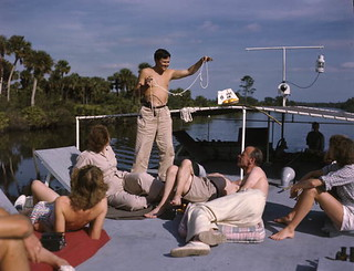 "Joe Steinmetz performing a magic trick aboard the shantyboat ""Lazy Bones"""