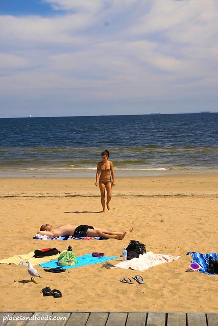 st kilda couple sunbathing