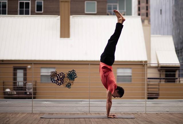 cute & little blog | wanderlust austin yoga festival | yoga handstand Adho Mukha Vrksasana pose