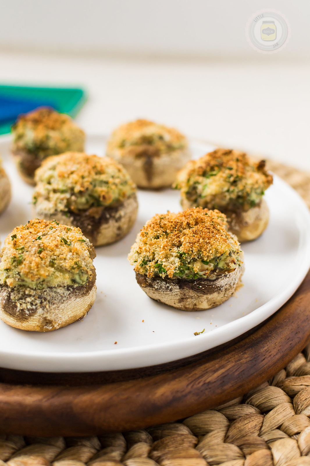 Spinach and Cream Cheese Stuffed Mushrooms Baked Vertical Closeup