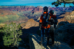 Mountain Bike Riders Looking at the Grand Canyon