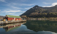 Seyðisfjörður's wooden buildings by the lake