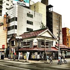 A glimpse of past between modern buildings in Sapporo, Japan. #instastreetphoto #japonia #streets #matsuri #instavideo #instagram #instacity #instajapan #instamania #instastreet #streets #nihon #nippon #city #sapporo #hokkaido #札幌 #日本 #instalike #instastr