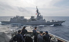 Sailors look on from USS Michael Murphy (DDG 112) while conducting a passing exercise with JS Teruzuki (DD 116), March 17. (U.S. Navy/MC2 Michaela Garrison)