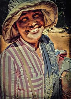 Image of Angkor Wat near Siem Reap. ankorarchaeologicalpark ankorwat cambodia hats holidays mangojouneys people smiles streettraders topazlabs