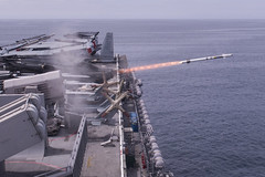 A rolling airframe missile (RAM) launches from USS America (LHA 6) during a live-fire missile exercise, April 6. (U.S. Navy/MCSN Chad Swysgood)