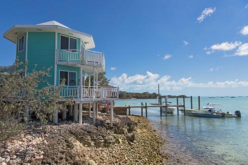 house peer sea water sky clouds rocks beach blue bahamas island vacation nikon d5