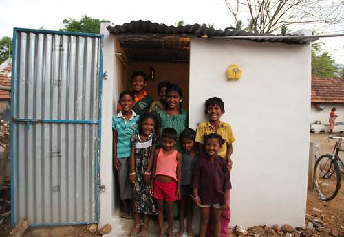 Children pose outside a household latrine in Sanarpudur, Namakkal