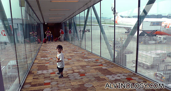 With priority boarding, Asher gets to be among the first to dash up the plane