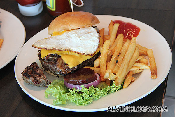 AUSSIE BURGER - Topped with melted Cheddar Cheese, grilled onions, crispy bacon, beetroot and a fried egg