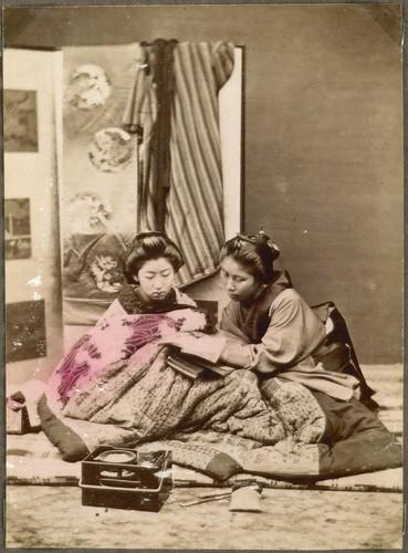 Two women reading, Japan.