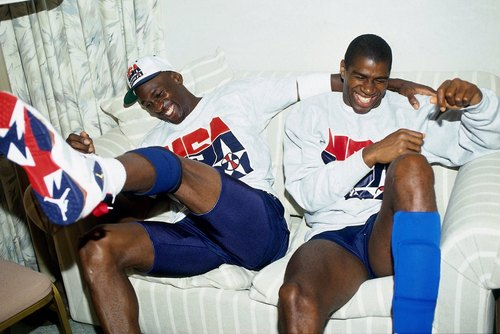 1992: Michael Jordan and Magic Johnson of the United States Basketball Team share a laugh during the 1992 Olympics in Barcelona, Spain.