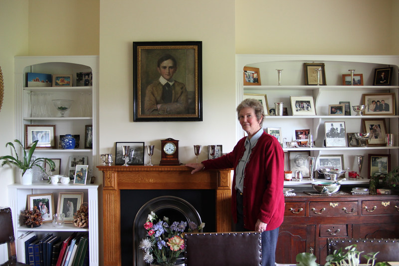 Beverley Mellstrum & portrait of her great grandfather Sidney Buchanen aged 14