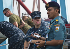 Lt. j.g. Kelly McWhorter, left, converses with Indonesian naval electrical officer Lt. Jaka Winanto aboard USS Tortuga (LSD 46) as the ship arrives in Jakarta, May 21. (U.S. Navy photo by Mass Communication Specialist 3rd Class Amanda S. Kitchner)