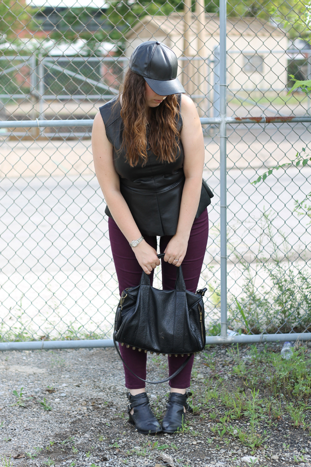 Leather Pops Outfit: Plum AG Stevie Ankle Jeans from Anthropologie, faux leather peplum top from Urban Outfitters, black leather Jeffrey Campbell Everly cutout ankle boots, leather baseball cap, studded-bottom bag