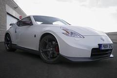 nissan 350z(0.0), automobile(1.0), automotive exterior(1.0), wheel(1.0), vehicle(1.0), automotive design(1.0), nissan 370z(1.0), nissan(1.0), bumper(1.0), land vehicle(1.0), luxury vehicle(1.0), supercar(1.0), sports car(1.0),