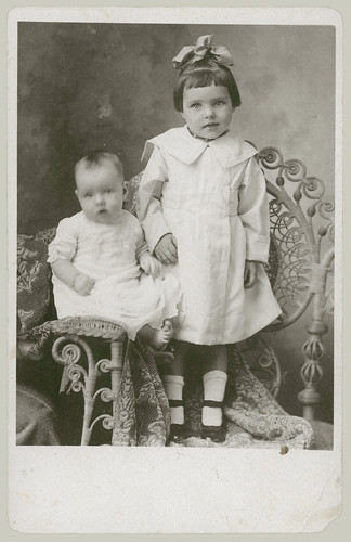 Two children in a rattan chair