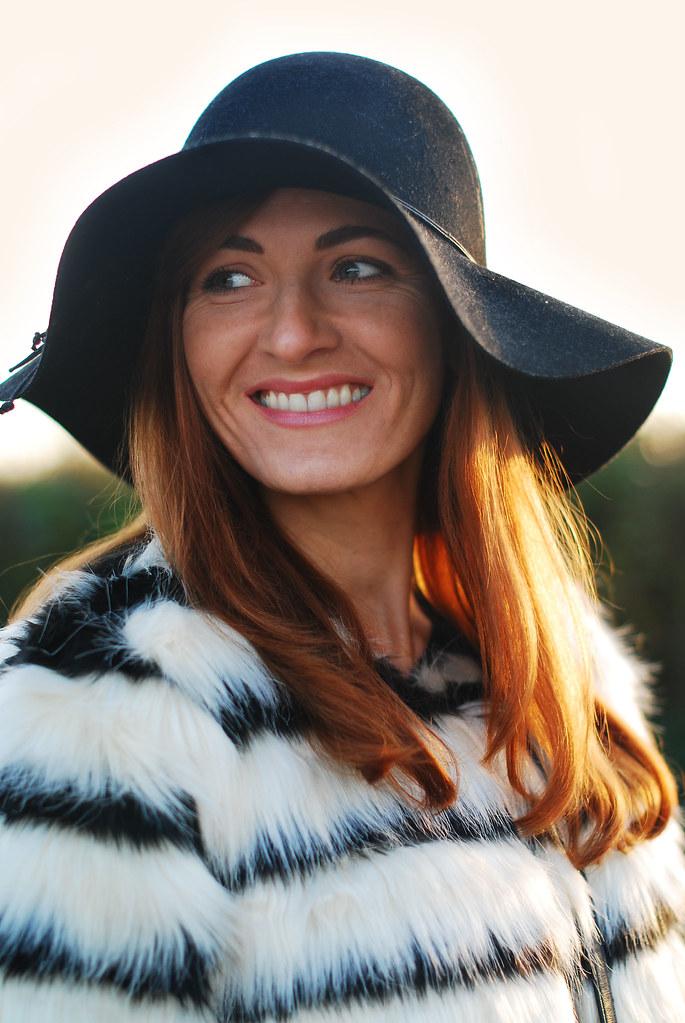 Black & white striped fur coat, black floppy hat