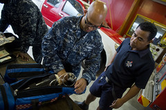 During a visit coordinated through Pacific Parnership, U.S. Navy Hospital Corpsman 2nd Class Jeffrey Garcia and a Samoan firefighter check the condition of medical equipment belonging to the Samoan Fire and Emergency Services Authority to ensure its readiness to respond in case of emergency. (U.S. Navy photo by Mass Communication Specialist 2nd Class Carlos M. Vazquez II)