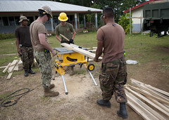 A combined team of engineers and Royal Tongan Marines cut pillars at the Atele Primary School during a Pacific Partnership engineering project. (U.S. Navy photo by Mass Communication Specialist 2nd Class Tim D. Godbee)