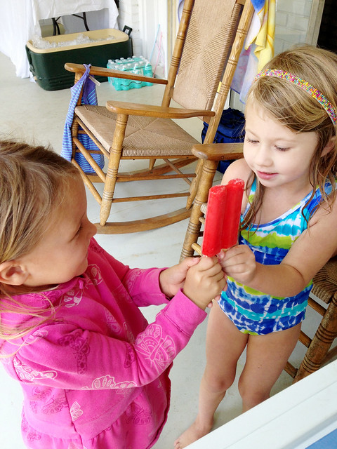 sassy and ella sharing a popsicle