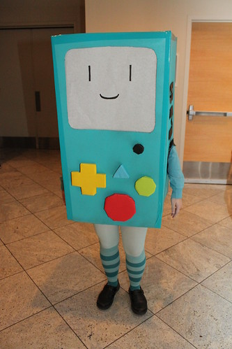 Someone who is actually me but you cannot tell because I am in a box and I look like a robot with human arms and legs.