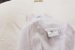 neck(0.0), collar(0.0), sleeve(0.0), cap(0.0), shirt(0.0), pattern(1.0), textile(1.0), clothing(1.0), outerwear(1.0), beige(1.0), design(1.0), sweater(1.0),