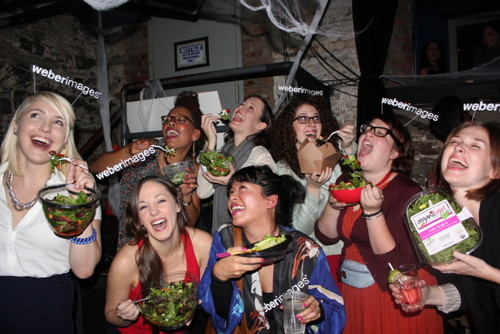 Women laughing alone with salad Halloween costume