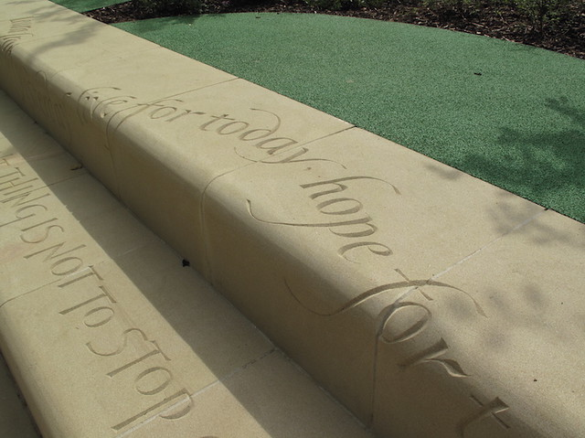 Hand carved quotation in the landscape.
