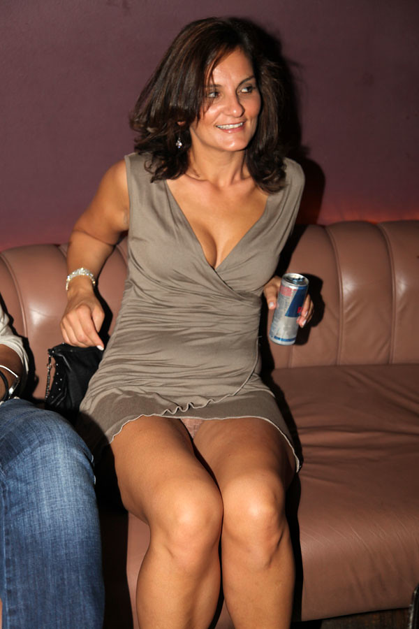 Mature women sitting upskirt