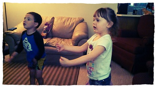 Lily and Conrad playing me kinect.