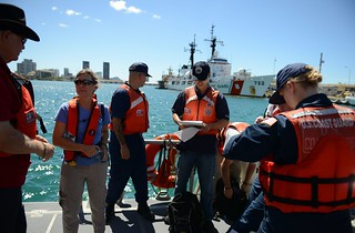 Crewmembers from the Coast Guard National Strike Force head to their first location to use a water quality instrument used to monitor depleted oxygen and pH levels in Honolulu Harbor, Honolulu Sept. 15, 2013. Personnel from the Coast Guard, U.S. Environmental Protection Agency, U.S. Fish and Wildlife, National Oceanic and Atmospheric Administration and Lockheed Martin tested the water at various locations around Honolulu Harbor affected by the molasses spill. U.S. Coast Guard photo by Petty Officer 3rd Class Tara Molle