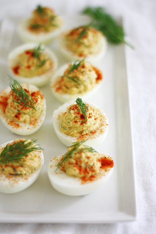 creamy deviled eggs with red onion, capers and dill