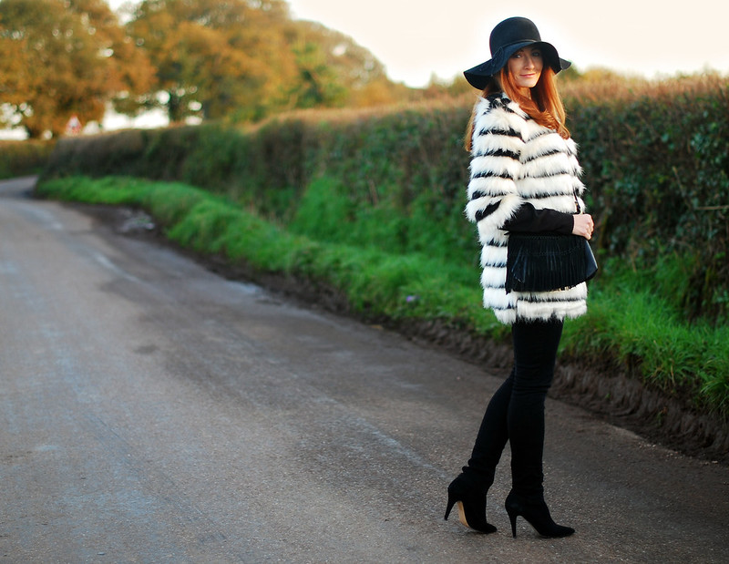 Black & white striped fur coat, black skinnies