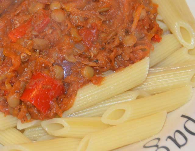 Vegetarian Spaghetti sauce on a bed of penne pasta