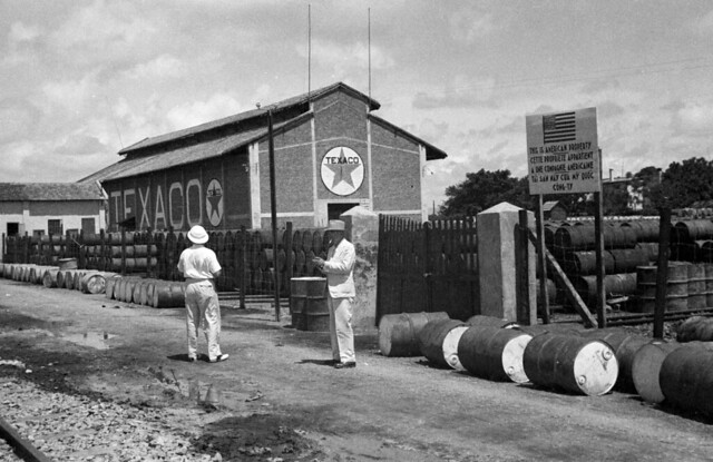 HAIPHONG 1940 - Men standing outside Texaco plant