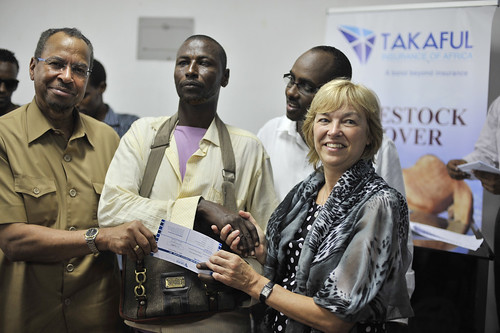 Jimmy Smith (left) and DFID's Lisa Phillips, at the Wajir insurance payouts