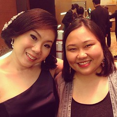 With the bride. Yellow lights make for really sallow skin tones in photos. :