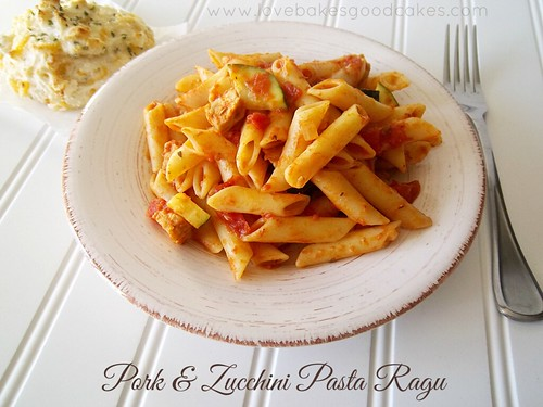 Pork & Zucchini Pasta Ragu in bowl with fork and {Copycat} Red Lobster Cheddar Bay Biscuit.