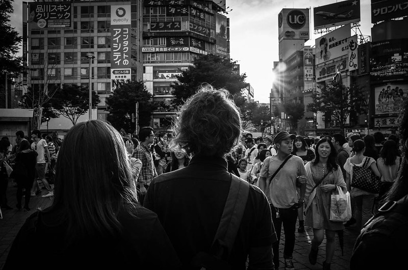 Hair light - a couple hit by the setting sun at Shibuya Crossing.