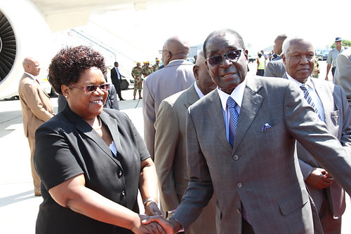 President Robert Mugabe says farewell to Vice-President Joice Mujuru enroute to Ethiopia for the special African Union summit on the International Criminal Court. The gathering is from October 12-13, 2013. by Pan-African News Wire File Photos