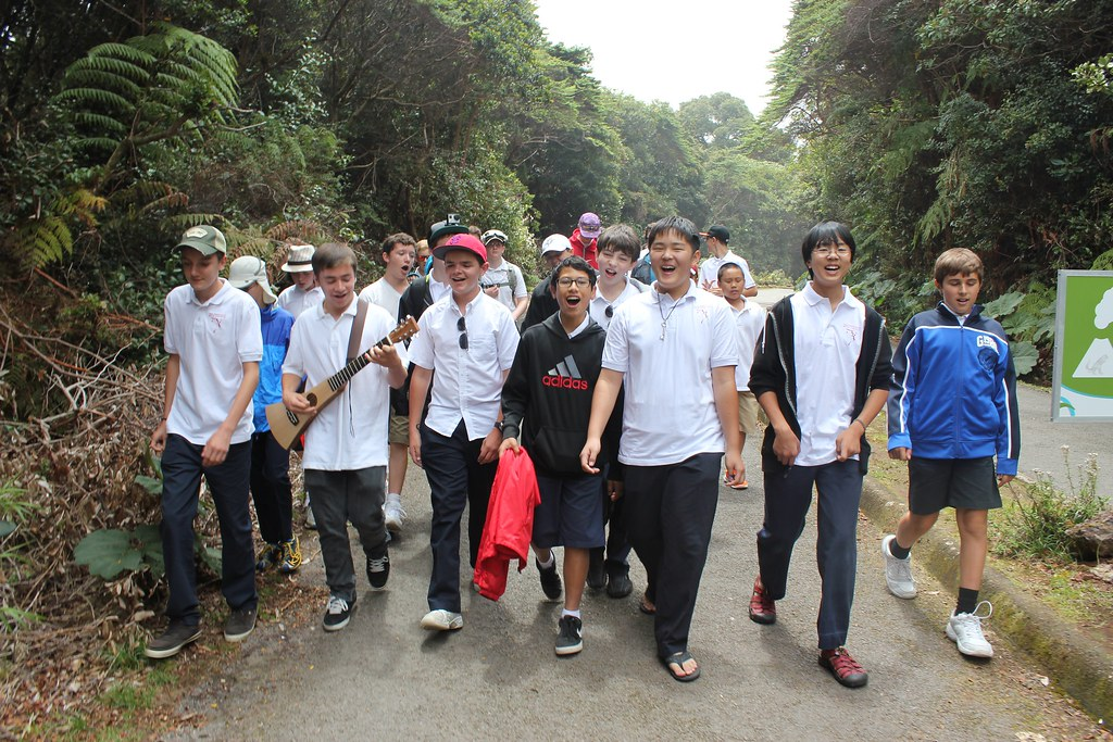 The San Francisco Boys Chorus has an informal sing-along during a sightseeing trip to Poas Volcano