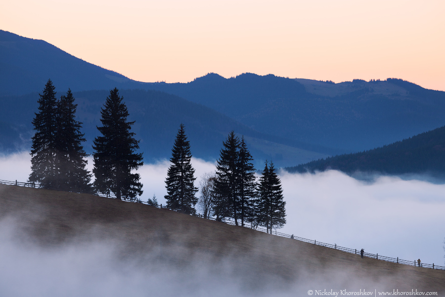 Mountains rural landscape at foggy sunrise