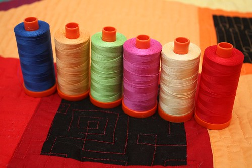 The line-up - Aurifil (all 50 wts) from L-R -  navy (#2735), orange (#2214), green (#5017), fuchsia (#2588), yellow (#2105), and red (#2250)