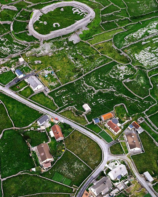 Looking down on Irishman (Inis Meáin) in the Aran Islands (Irish: Oileáin Árann) you can connect the Iron Age with the modern world and see many of the steps in between. Dún Chonchúir (Conor's Fort) is a ringfort started in pre-Christian times that is now