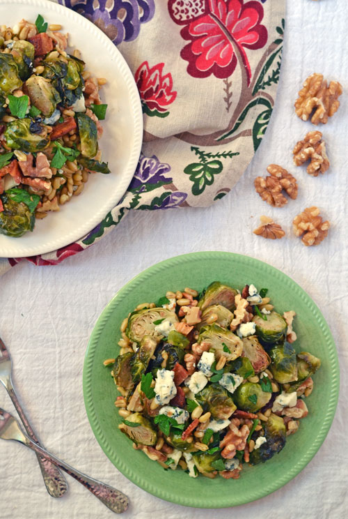 Warm Brussels sprouts salad on white and green plates