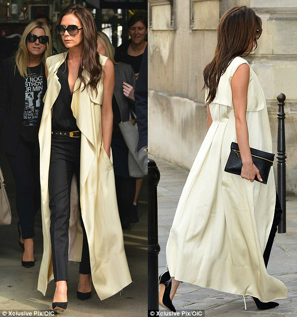 cream cape-style coat, floor-length cape, sleeveless duster coat, lemon duster sleeveless trench coat, Victoria beckham