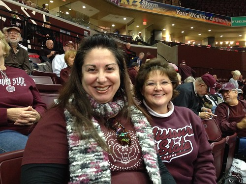 A maroon and white cheering section